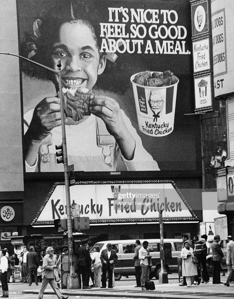 A billboard over a Kentucky Fried Chicken fast food outlet in New York City 1980