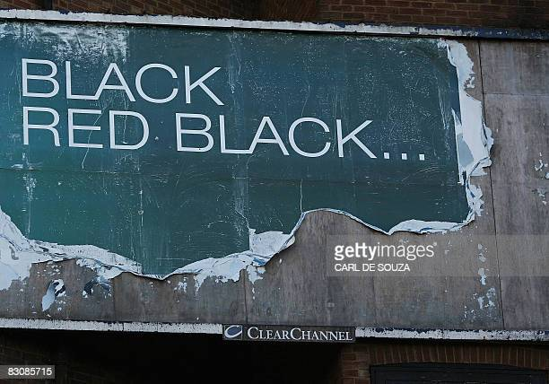 A billboard poster is pictured in Aldershot in Hampshire in southern England on October 1 2008 Britain's economy experienced zero growth in the...