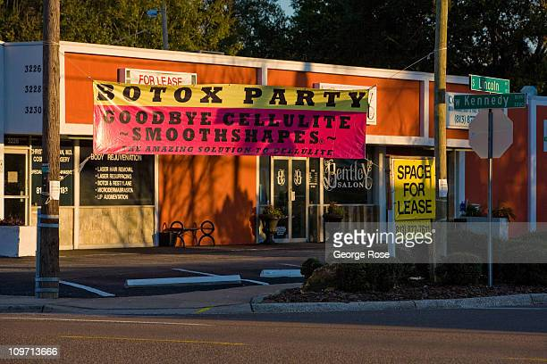 A billboard promoting a botox party on Kennedy Blvd flies in the wind on February 14 2011 in Tampa Florida Hit hard by the recent economic downturn...
