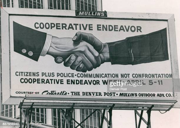 Billboard Salutes Cooperation The latest community service billboard atop Cottrell's Men's Store 16th and Welton Sts salutes Cooperative Endeavor...
