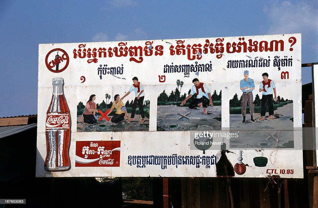 A billboard sponsored by Cocacola warning local people about the danger of mines in Battambang Cambodia