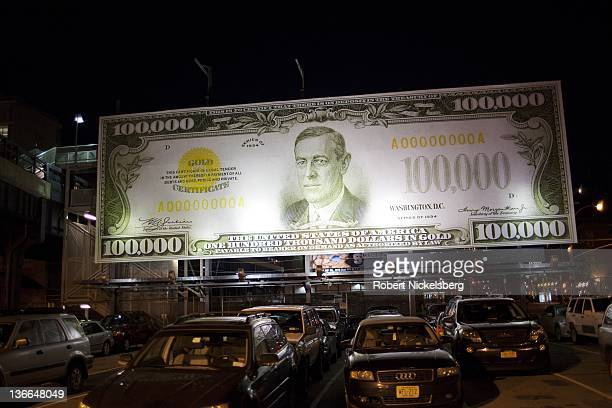 A billboard stands above a parking lot advertising with a created 100000 USD currency denomination in New York City December 23 2011 Former US...
