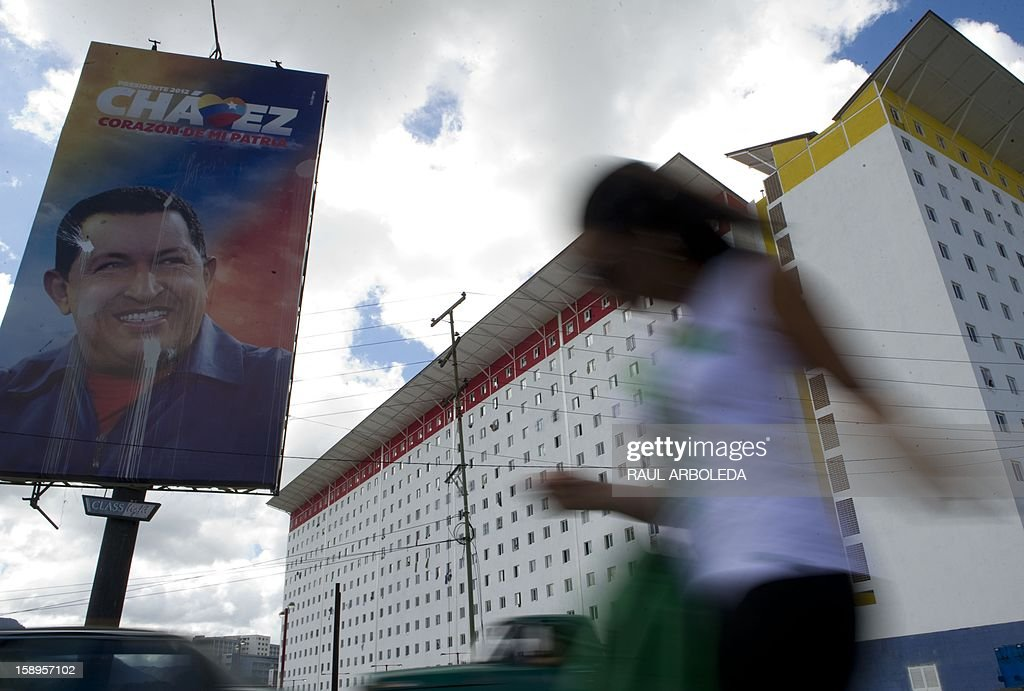 A billboard with an image of Venezuelan President Hugo Chavez is seen in the streets of Caracas on January 4, 2013. Hugo Chavez's top aides have gone on the offensive, accusing the opposition and media of waging a 'psychological war,' as Venezuela's cancer-stricken president battles a serious lung infection. The closing of ranks followed a high-level gathering of top Venezuelan officials in Havana with Chavez, amid growing demands to know whether he will be fit on January 10 to take the oath of office for another six-year-term. AFP PHOTO/Raul ARBOLEDA