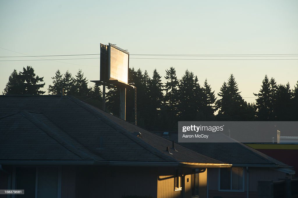 Billboard without advertisement over roofs : Stock Photo