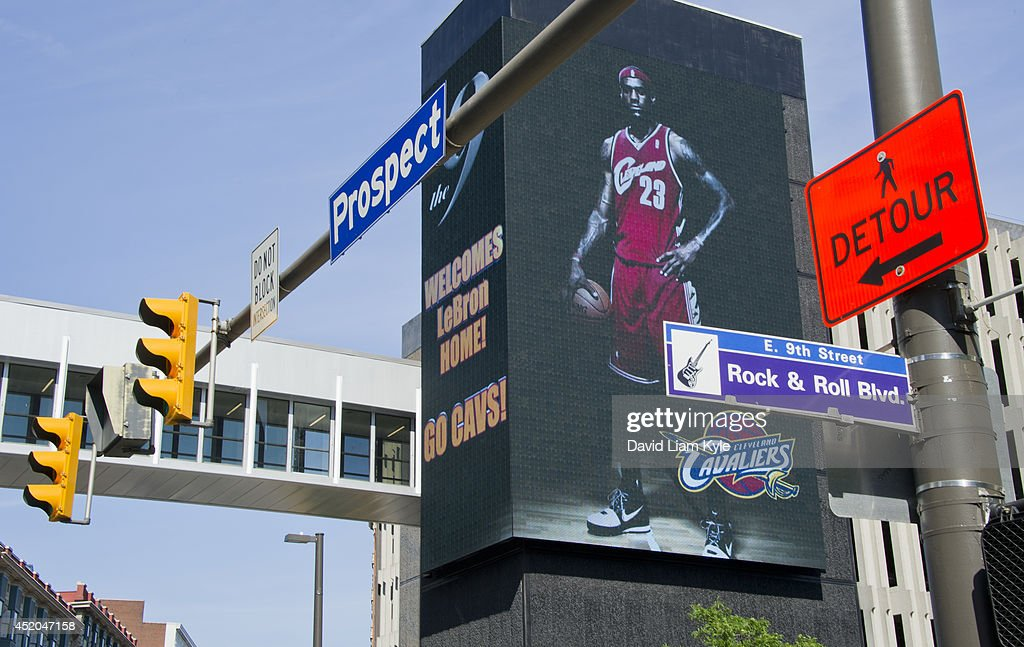 Billboards light up signaling the return of <a gi-track='captionPersonalityLinkClicked' href=/galleries/search?phrase=LeBron+James&family=editorial&specificpeople=201474 ng-click='$event.stopPropagation()'>LeBron James</a> to the Cleveland Cavaliers after a short 'detour' on July 11, 2014 in Cleveland, Ohio.