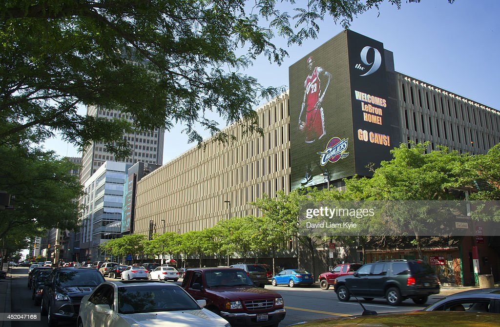Billboards light up signaling the return of <a gi-track='captionPersonalityLinkClicked' href=/galleries/search?phrase=LeBron+James&family=editorial&specificpeople=201474 ng-click='$event.stopPropagation()'>LeBron James</a> to the Cleveland Cavaliers on July 11, 2014 in Cleveland, Ohio.