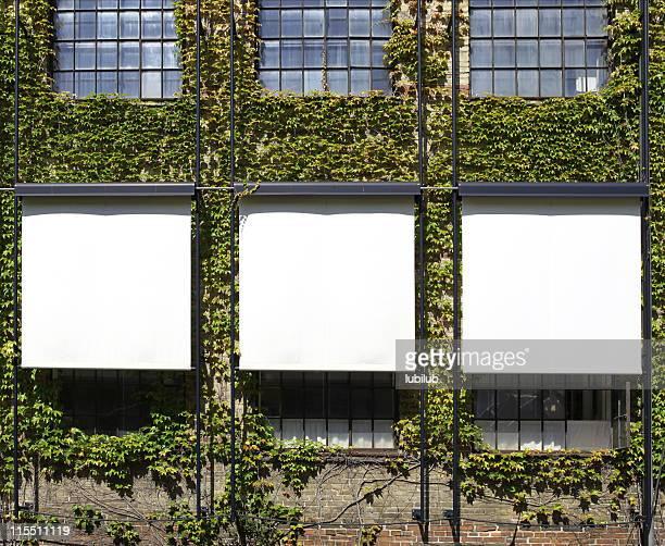 Billboards outside old  factory building