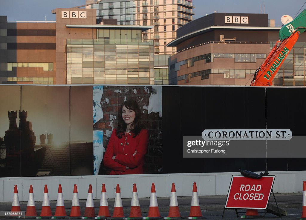 Billboards surround the new Granada ITV construction site next to the BBC studios at Media City on January 30, 2012 in Salford, England. The cobbled streets of ITV soap opera 'Coronation Street' is one of the many departments moving to the new studios in Salford. The new complex is being built on the banks of Manchester Ship Canal opposite the BBC in Media City.