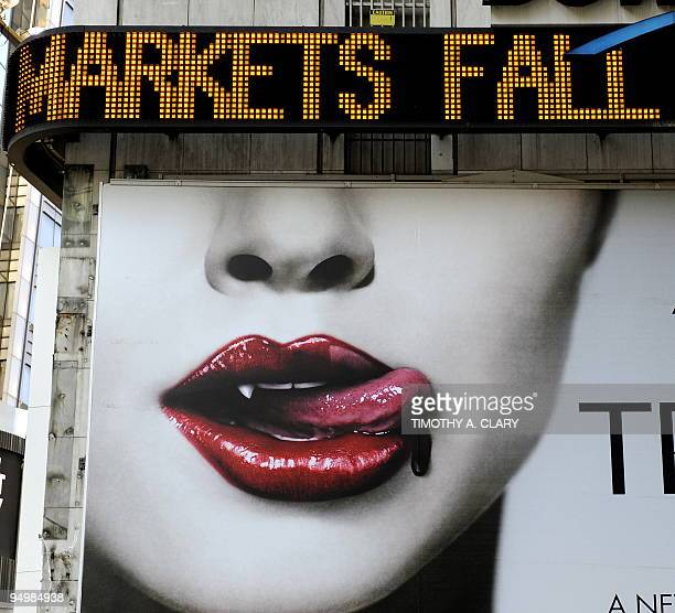 Billboards surround the Times Square Electronic Ticker Tape as it displays news about the Federal Reserve announcing October 7 2008 a plan to buy...