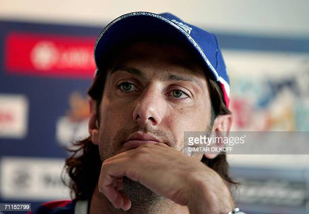 Serbia and Montenegro's forward Mladen Krstajic contemplates a journalist's question during a news conference in Billerbeck 08 June 2006 Serbia and...