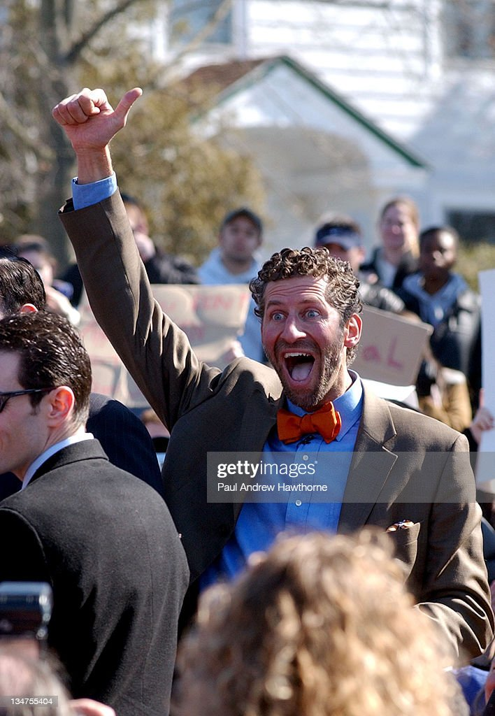 Billian Von Rostenberg of New Paltz New York raises his arm in jubilation after a Solemnizing ceremony with his partner Major Jeffrey McGowan at the...
