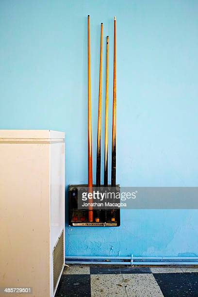 Billiard sticks mounted on wall