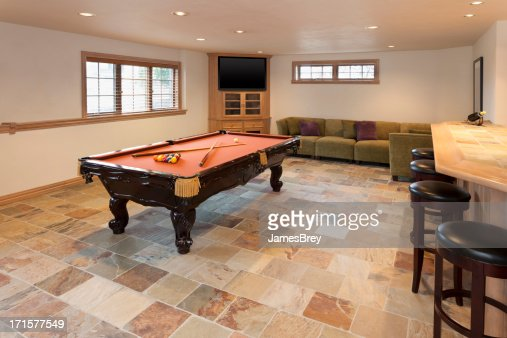 basement games room pool table stock photo | getty images