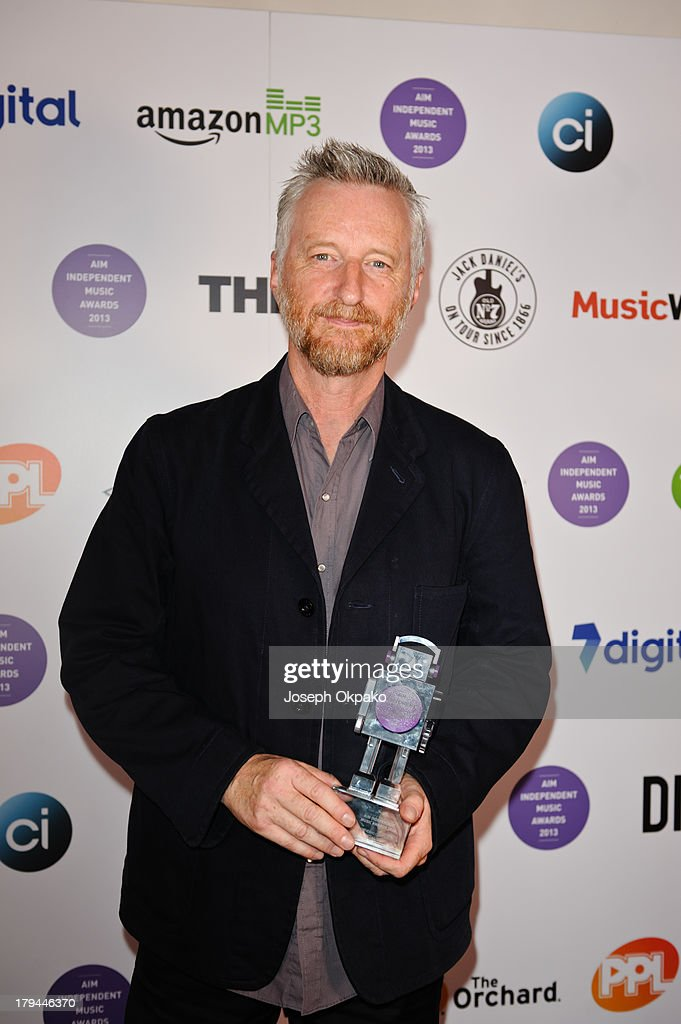 Billie Bragg wins an award for Outstanding Contribution To Music at the AIM Independent Music Awards at The Brewery on September 3, 2013 in London, England.