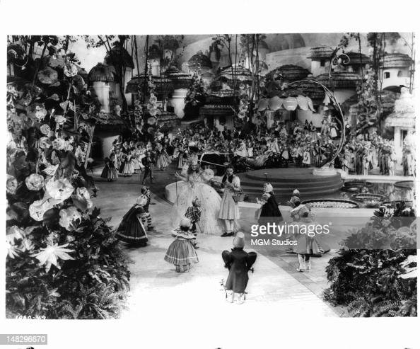 Billie Burke as Glinda the Good Witch introduce Judy Garland to the munchkins in a scene from the film 'The Wizard Of Oz' 1939