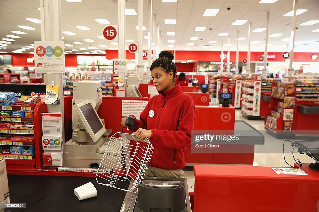 Billie Coleman rings up a customer's merchandise at a Target store on October 10, 2013 in Chicago, Illinois. The store, which opened on October 8, was built on land where the notorious Cabrini-Green housing project once stood. The last of the Cabrini-Green high-rise homes were demolished two years ago. The housing project has been replaced with townhomes and retail shops, with some of the property being left vacant.