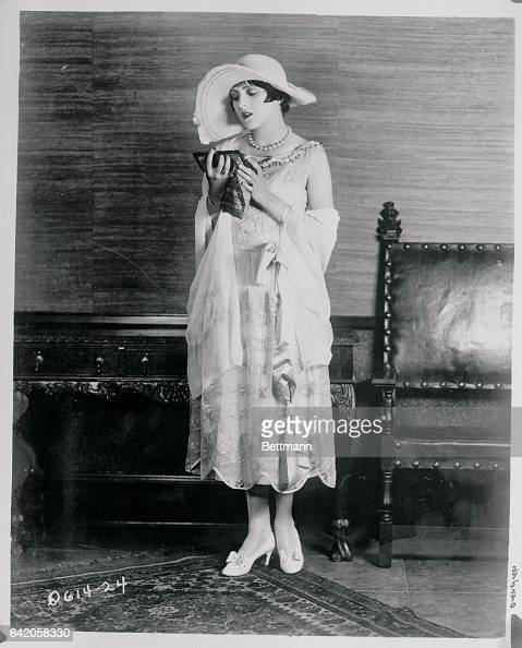 Billie Dove declares that nothing can take the place of a lace garden frock This season Miss Dove selected this ecru embroidered net and lace gown...