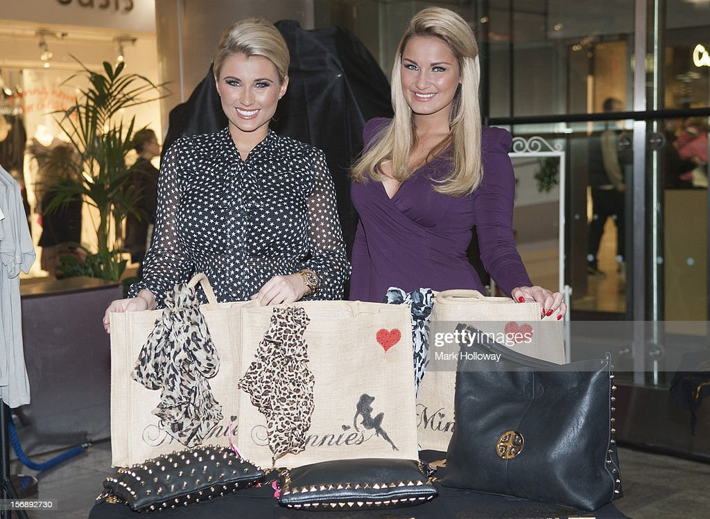 Billie Faiers and <a gi-track='captionPersonalityLinkClicked' href=/galleries/search?phrase=Sam+Faiers&family=editorial&specificpeople=7324872 ng-click='$event.stopPropagation()'>Sam Faiers</a> launch their new pop Up Shop called Minnies Boutique at West Quay on November 24, 2012 in Southampton, England.