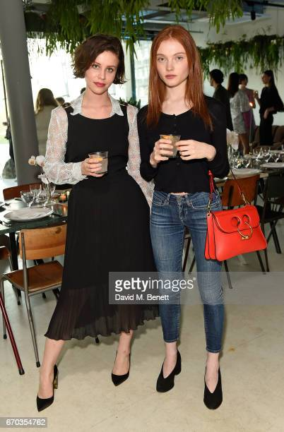 Billie JD Porter and Georgie Hobday attend the Kenzo World fragrance launch at The Store on April 19 2017 in London England