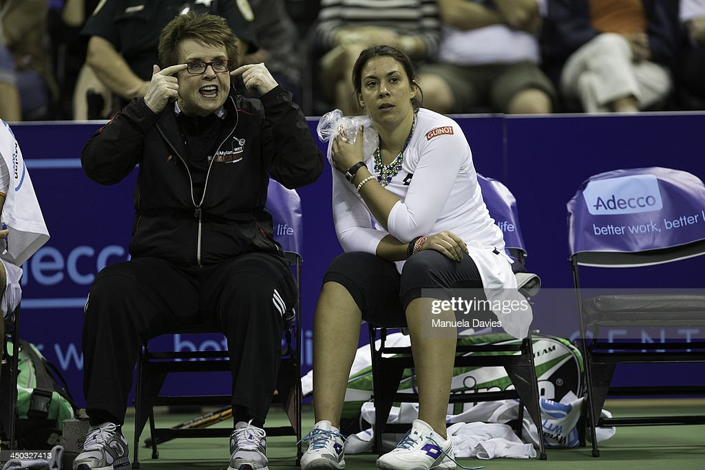 <a gi-track='captionPersonalityLinkClicked' href=/galleries/search?phrase=Billie+Jean+King&family=editorial&specificpeople=93147 ng-click='$event.stopPropagation()'>Billie Jean King</a> and <a gi-track='captionPersonalityLinkClicked' href=/galleries/search?phrase=Marion+Bartoli&family=editorial&specificpeople=227896 ng-click='$event.stopPropagation()'>Marion Bartoli</a> on the bench during the 2013 Mylan WTT Smash Hits on November 17, 2013 at the ESPN Wide World of Sports Complex in Lake Buena Vista, Florida.