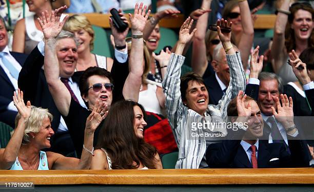Billie Jean King Catherine Duchess of Cambridge and Prince William Duke of Cambridge participate in the wave during the fourth round match between...