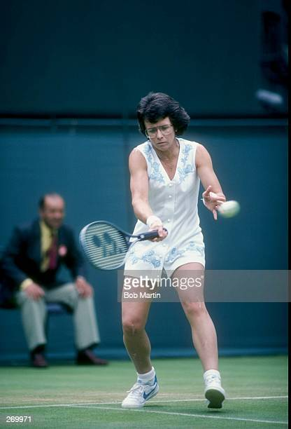 Billie Jean King hits the ball during a match at Wimbledon in England
