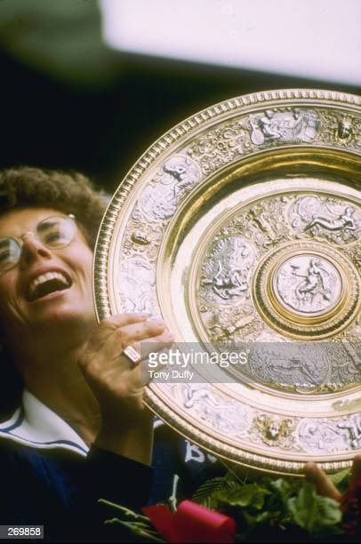 Billie Jean King holds her trophy after winning at Wimbledon in England