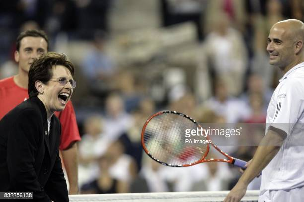 Billie Jean King jokes with USA's Andre Agassi over the coin toss ahead of his match against Andrei Pavel during the US Open at Flushing Meadow New...