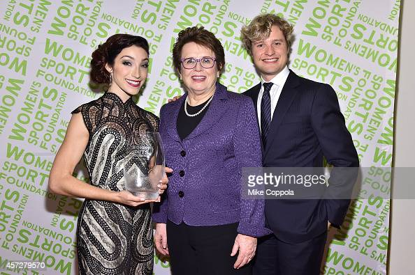 Billie Jean King presents Olympic gold medal winning ice dancer Meryl Davis with the Sportswoman of the Year Award and Charlie White during the...