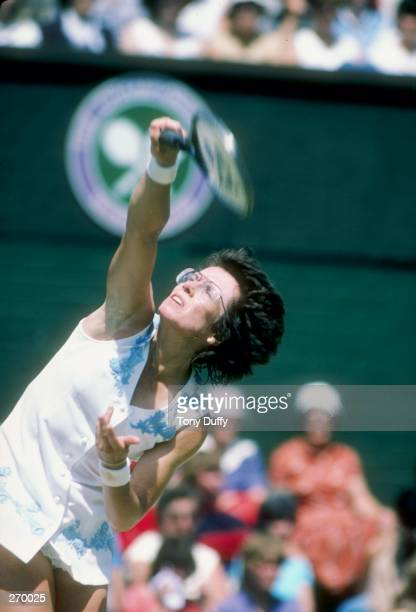 Billie Jean King serves the ball during a match at Wimbledon in England