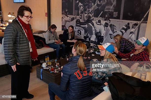 Billie Jean King speaks to US Olympians Kacey Bellamy and Brianne McLaughlin during their visit to the USA House in the Olympic Village on February...