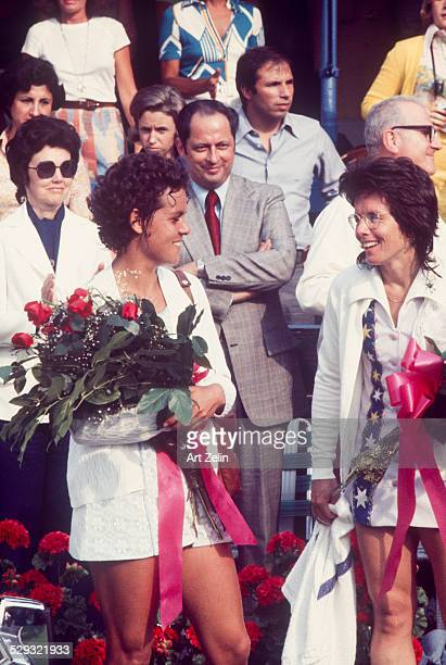 Billie Jean King with Pam Shriver each holding roses after a tennis match circa 1970 New York