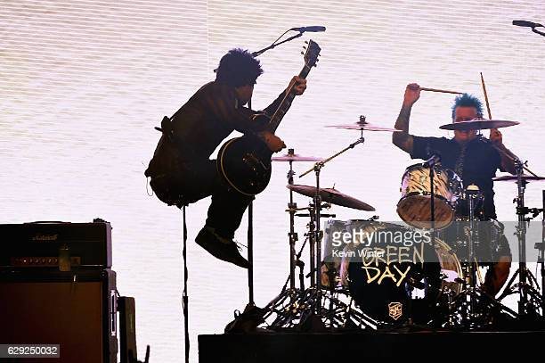 Billie Joe Armstrong and drummer Tre Cool of the band Green Day perform onstage at 1067 KROQ Almost Acoustic Christmas 2016 Night 2 at The Forum on...