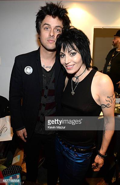 Billie Joe Armstrong and Joan Jett backstage during The 6th Annual Little Kids Rock Benefit at Hammerstein Ballroom on October 23 2014 in New York...