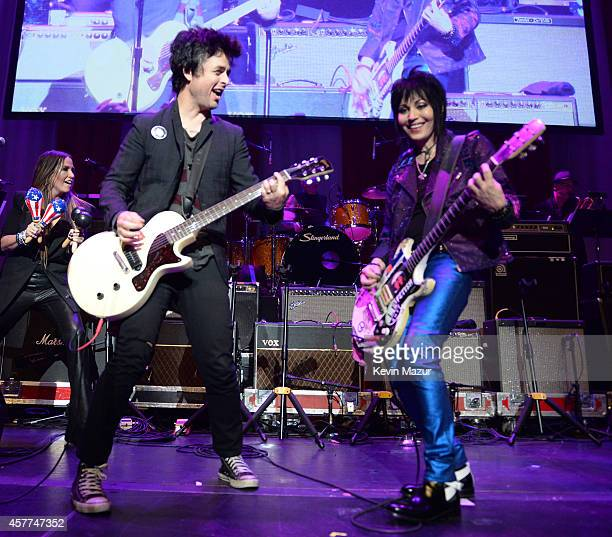 Billie Joe Armstrong and Joan Jett perform onstage during The 6th Annual Little Kids Rock Benefit at Hammerstein Ballroom on October 23 2014 in New...