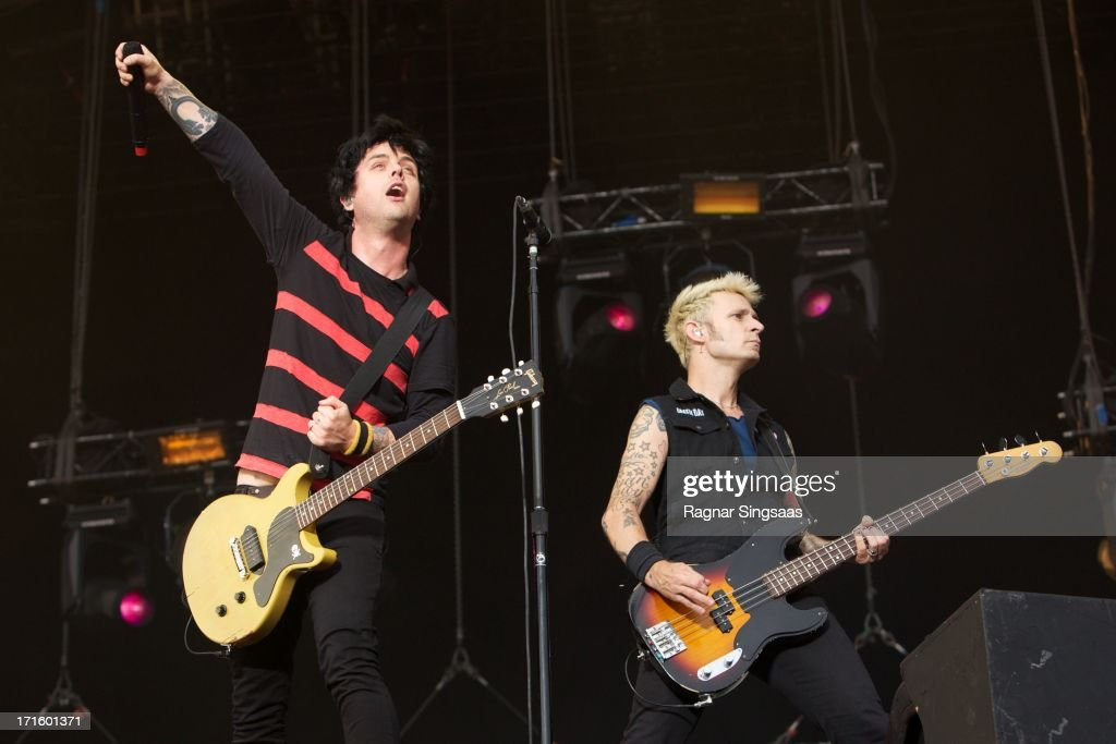 Billie Joe Armstrong and Mike Dirnt of Green Day perform on stage headlining on Day 1 of Rock The Beach Festival on June 26, 2013 in Helsinki, Finland.