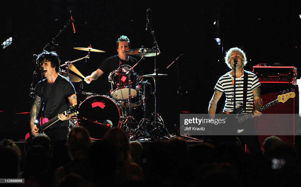 <a gi-track='captionPersonalityLinkClicked' href=/galleries/search?phrase=Billie+Joe+Armstrong&family=editorial&specificpeople=201545 ng-click='$event.stopPropagation()'>Billie Joe Armstrong</a>, Frank Wright AKA Tre Cool and <a gi-track='captionPersonalityLinkClicked' href=/galleries/search?phrase=Mike+Dirnt&family=editorial&specificpeople=204154 ng-click='$event.stopPropagation()'>Mike Dirnt</a> of Green Day perform on stage at the 27th Annual Rock And Roll Hall Of Fame Induction Ceremony at Public Hall on April 14, 2012 in Cleveland, Ohio.