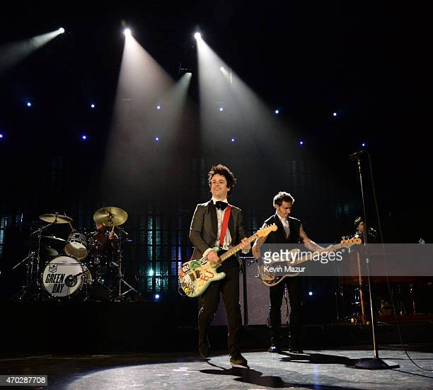 Billie Joe Armstrong Mike Dirnt and Tre Cool of Green Day perform onstage during the 30th Annual Rock And Roll Hall Of Fame Induction Ceremony at...