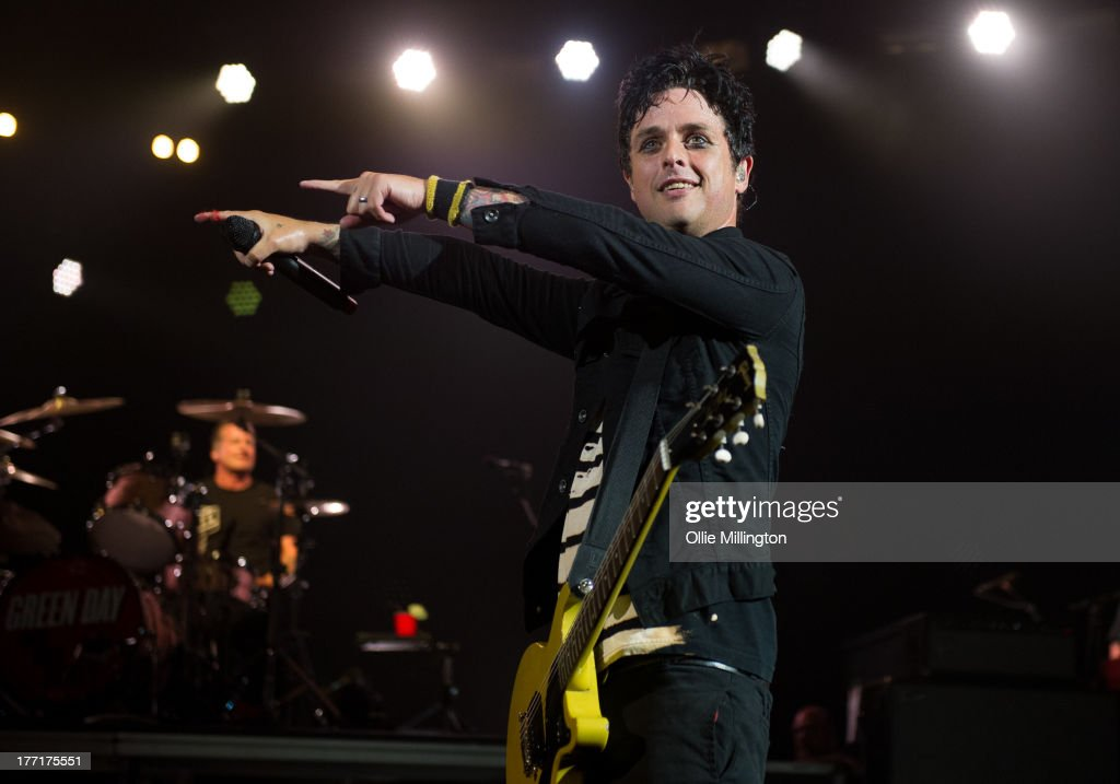 <a gi-track='captionPersonalityLinkClicked' href=/galleries/search?phrase=Billie+Joe+Armstrong&family=editorial&specificpeople=201545 ng-click='$event.stopPropagation()'>Billie Joe Armstrong</a> of Green Day perform onstage at Brixton Academy on August 21, 2013 in London, England.