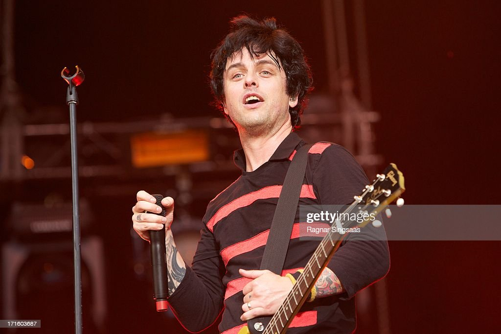 <a gi-track='captionPersonalityLinkClicked' href=/galleries/search?phrase=Billie+Joe+Armstrong&family=editorial&specificpeople=201545 ng-click='$event.stopPropagation()'>Billie Joe Armstrong</a> of Green Day performs on stage headlining on Day 1 of Rock The Beach Festival on June 26, 2013 in Helsinki, Finland.