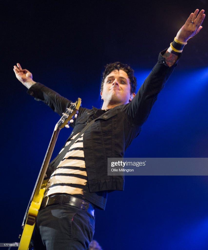 <a gi-track='captionPersonalityLinkClicked' href=/galleries/search?phrase=Billie+Joe+Armstrong&family=editorial&specificpeople=201545 ng-click='$event.stopPropagation()'>Billie Joe Armstrong</a> of Green Day performs onstage at Brixton Academy on August 21, 2013 in London, England.