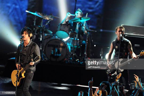 Billie Joe Armstrong Tre Cool and Mike Dirnt of Green Day perform onstage during the 2009 MTV Video Music Awards at Radio City Music Hall on...