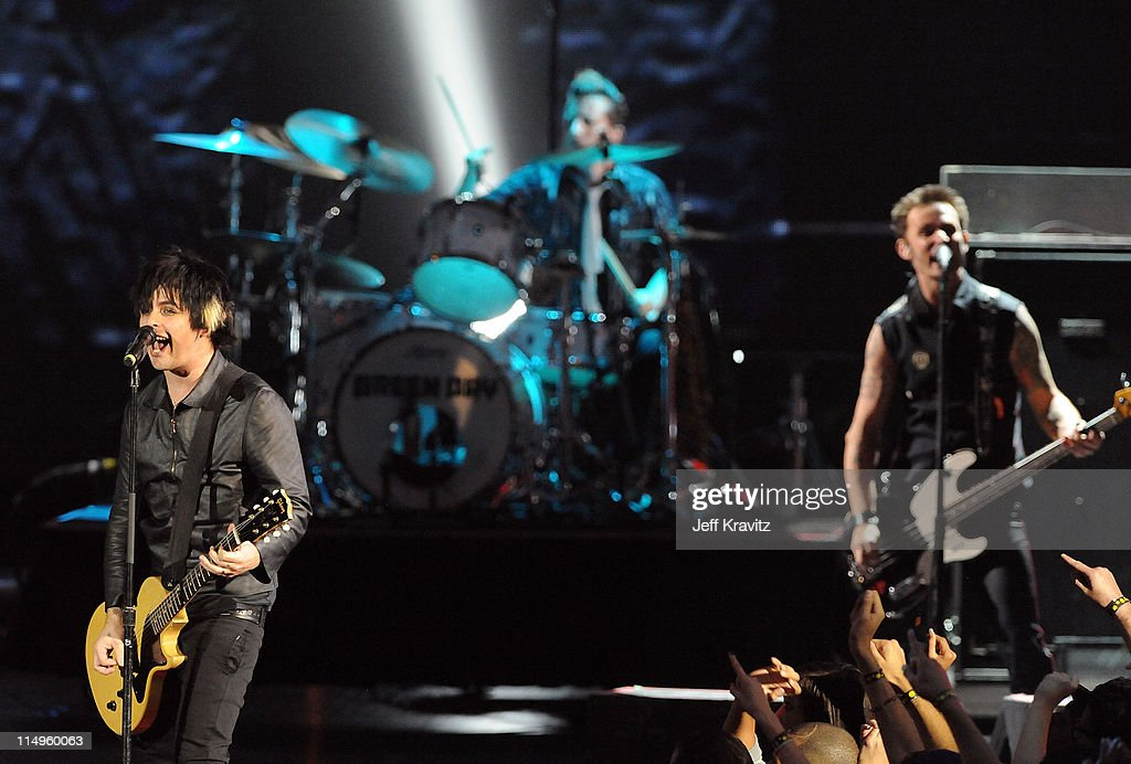 Billie Joe Armstrong, Tre Cool and Mike Dirnt of Green Day perform onstage during the 2009 MTV Video Music Awards at Radio City Music Hall on September 13, 2009 in New York City.