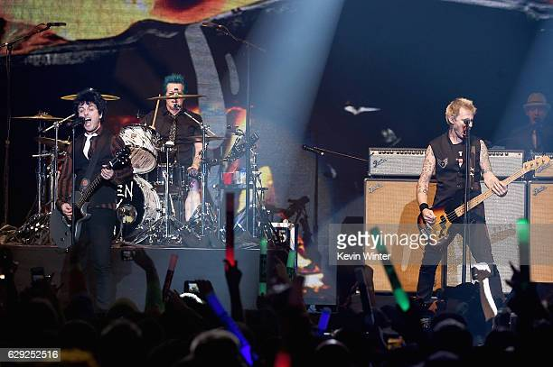 Billie Joe Armstrong Tre Cool and Mike Dirnt of the band Green Day perform onstage at 1067 KROQ Almost Acoustic Christmas 2016 Night 2 at The Forum...