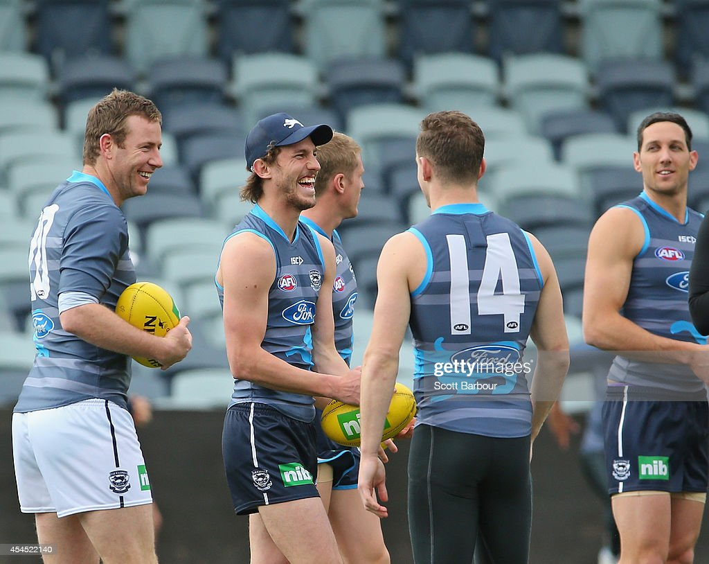 Billie Smedts, Josh Caddy, Joel Selwood and Harry Taylor look on as Steve Johnson arrives at a Geelong Cats AFL training session at Simonds Stadium on September 3, 2014 in Geelong, Australia.