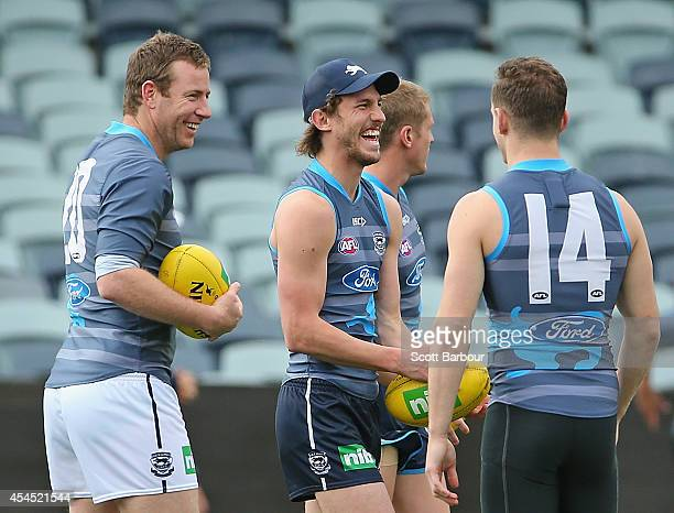 Billie Smedts Josh Caddy Joel Selwood look on as Steve Johnson arrives at a Geelong Cats AFL training session at Simonds Stadium on September 3 2014...