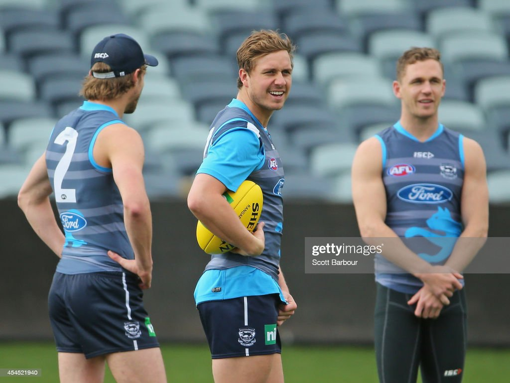 Billie Smedts, Mitch Duncan and <a gi-track='captionPersonalityLinkClicked' href=/galleries/search?phrase=Joel+Selwood&family=editorial&specificpeople=4521436 ng-click='$event.stopPropagation()'>Joel Selwood</a> look on during at a Geelong Cats AFL training session at Simonds Stadium on September 3, 2014 in Geelong, Australia.