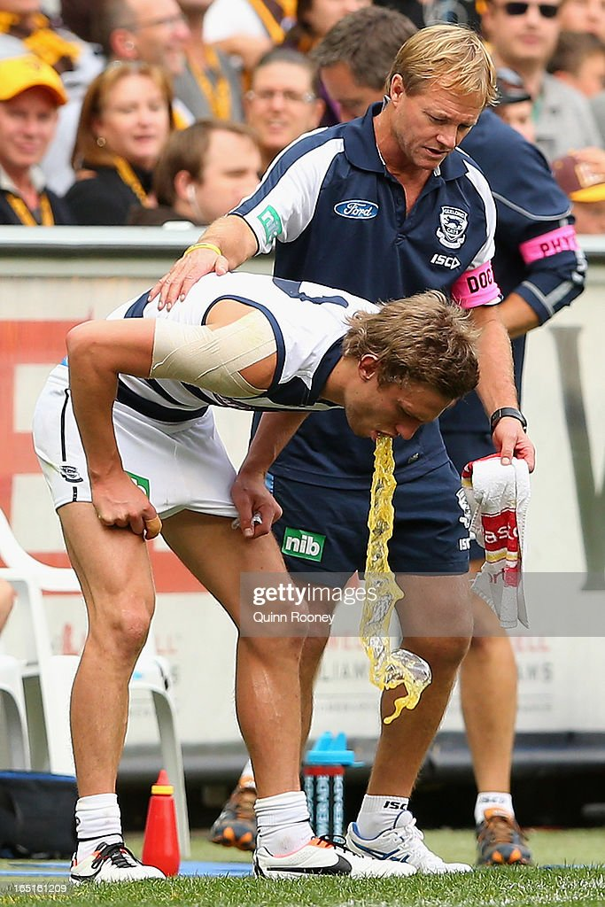 Billie Smedts of the Cats throws up on the boundary line after taking a heavy knock during the round one AFL match between the Hawthorn Hawks and the Geelong Cats at the Melbourne Cricket Ground on April 1, 2013 in Melbourne, Australia.