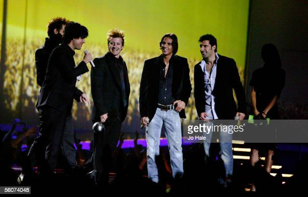 BillieJoe Armstrong Mike Dirnt and Tre Cool of Green Day receive the Best Rock Act from Nuno Gomes and Luis Figo at the 12th annual MTV Europe Music...