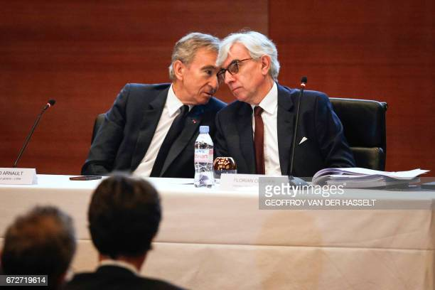 Group chief executive officer Bernard Arnault speaks to LVMH Group General manager Florian Ollivier during a press conference on April 25 2017 in...